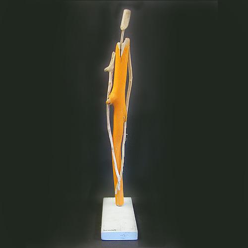 Amy lansburg driftwood sculpture on a pedestal.